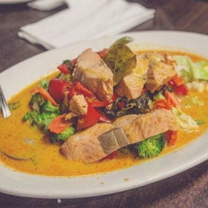 Rich Thai red curry and salmon.