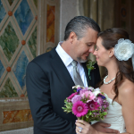 Bride and Groom touch foreheads under the arches at Bethesda Terrace