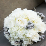 White Bridal bouquet of roses and hydrangea with silver brunia