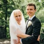 Bride and groom hug each other in Shakespeare Garden