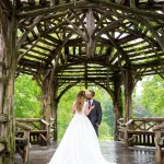 Bride and groom kissing in the Treehouse for Dreaming on a rainy day