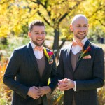 Two grooms smiling after getting married in Central Park