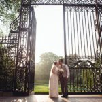 Couple Kissing outside of main gate of Conservatory Garden