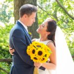 Wedding Couple with Bride holding bouquet of sunflowers