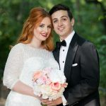 Bride and groom portrait with bride holding bouquet of blush flowers