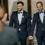 Two Grooms walking to ceremony at Bethesda Fountain