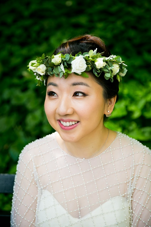 Petite bridal floral crown of white spray roses and greenery