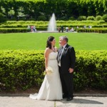 Newlyweds looking at each other in front of the Italian Garden and fountain