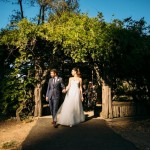 Bride and groom walking out of Cop Cot during golden hour