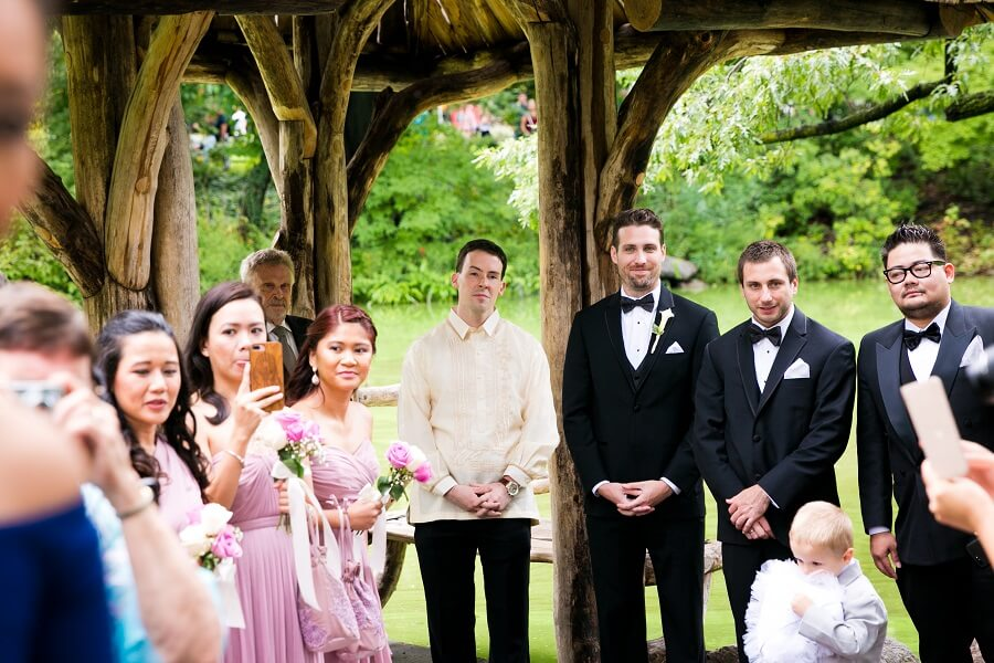 Groom and guests waiting for bride to walk down aisle at Wagner Cove