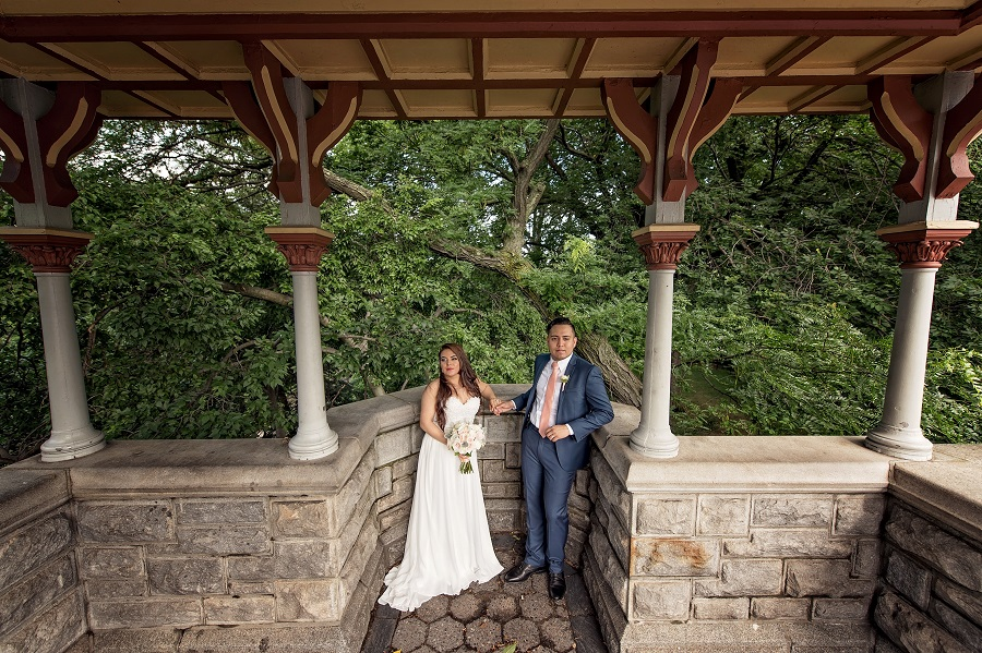 Newlyweds pose under terrace at Belvedere Castle