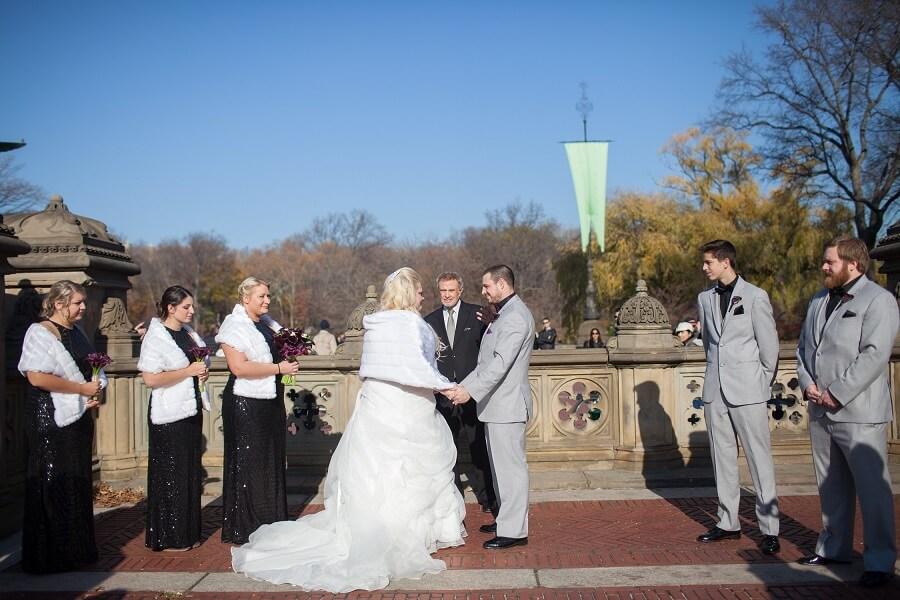 Winter wedding ceremony at Bethesda Fountain terrace