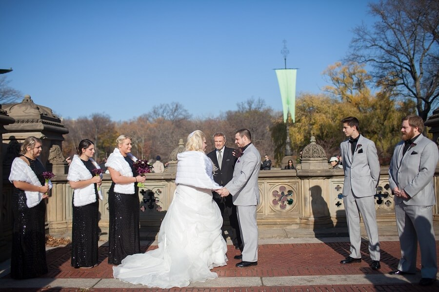 Winter wedding ceremony at Bethesda Fountain terrace
