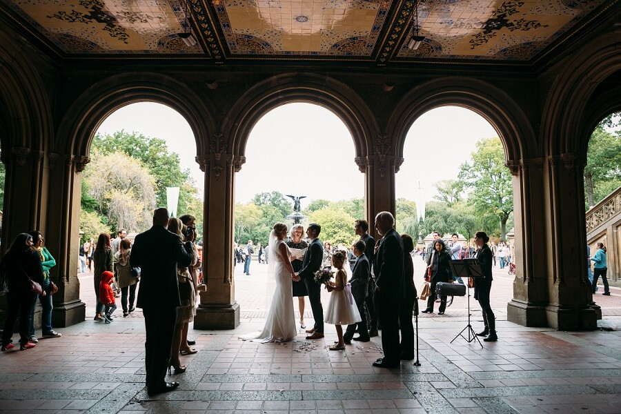 Intimate wedding ceremony under the arches at Bethesda Fountain