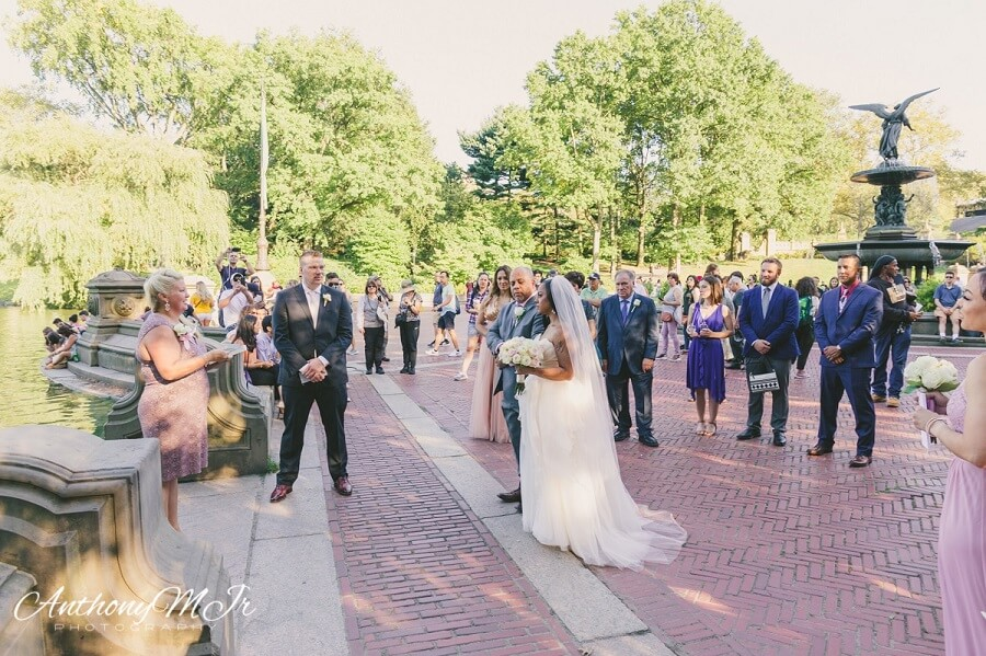 Bride walks down aisle with dad at Bethesda Fountain in Central Park