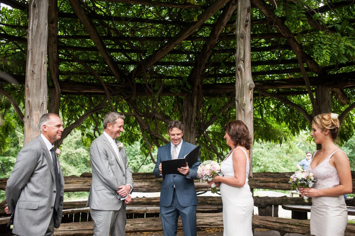 NYC Outdoor Wedding Venues & Locations: Couple getting married inside Cop Cot Central Park