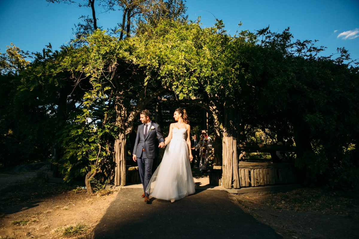 NYC outdoor wedding venues & locations: Newlyweds exiting Cop Cot during golden hour