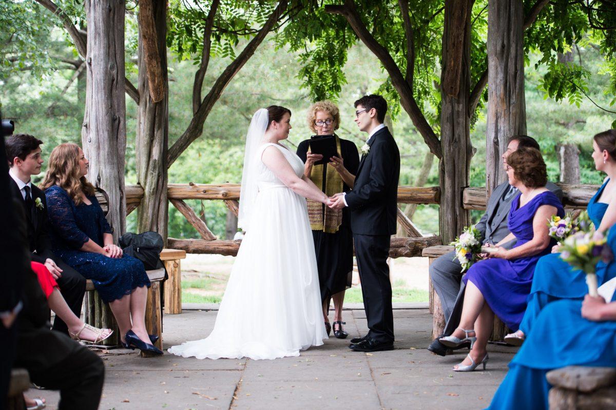 NYC Outdoor Wedding Venues & Locations: Couple exchanges wedding vows at Cop Cot Central Park