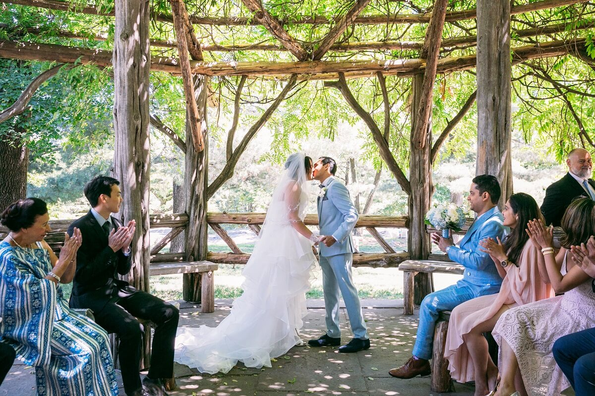 NYC Outdoor Wedding Venues & Locations: Couple kisses as pronounced married at Cop Cot
