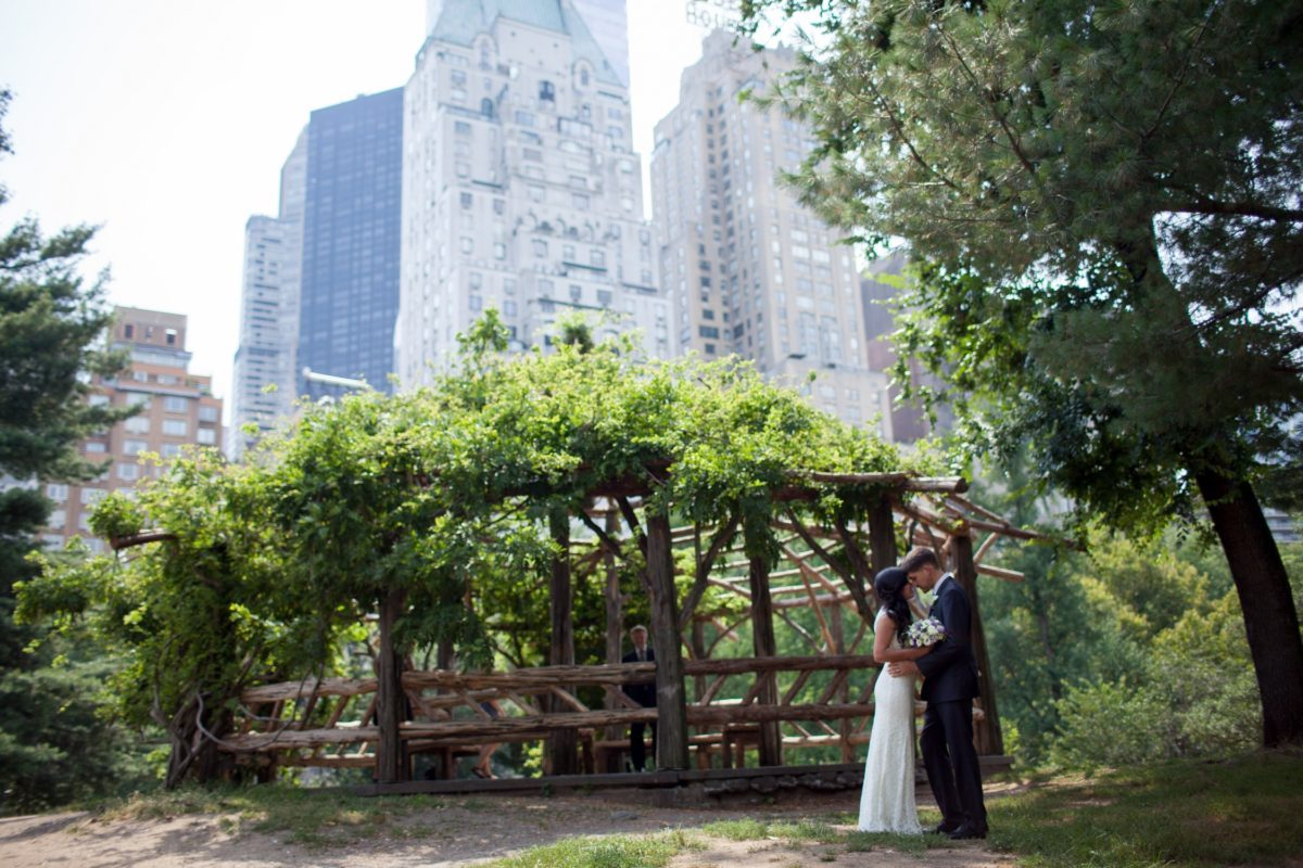 NYC Outdoor Wedding Venues & Locations: Newlyweds outside of Cop Cot with Essex House in background