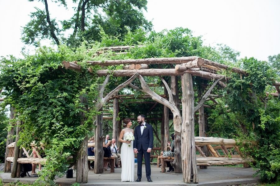 NYC Outdoor Wedding Venues & Locations: Bride and groom standing in front of Cop Cot gazebo