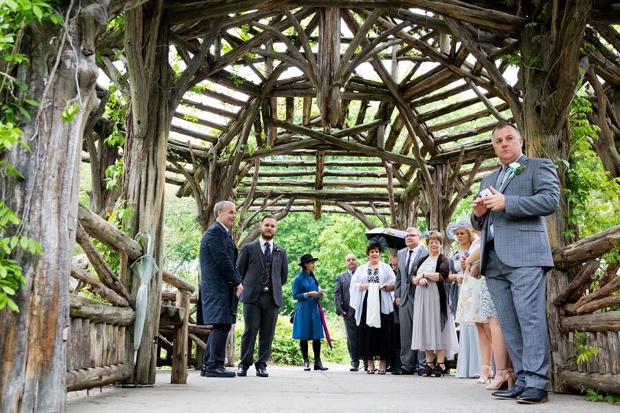 Wedding guests and groom await bride at Dene Summerhouse gazebo