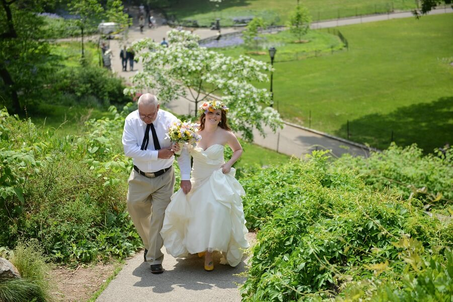 Bride escorted by dad down aisle at Dene Summerhouse