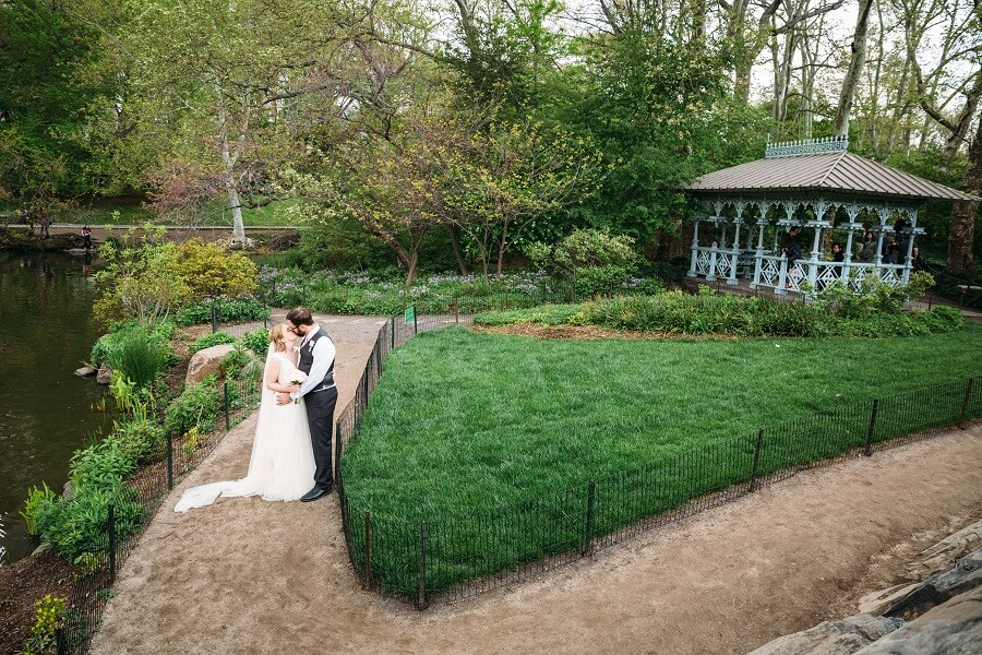 Bride and groom kissing outside of the Ladies Pavilion