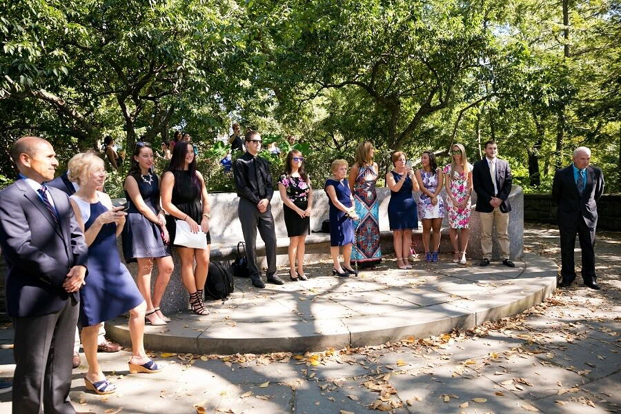 Wedding guests wait for the bride to arrive at Shakespeare Garden