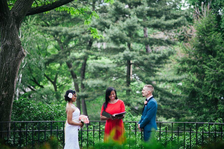 Bride and groom exchanging wedding vows in Shakespeare Garden