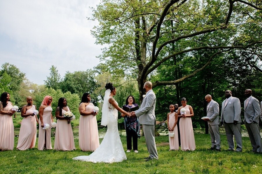 Wedding ceremony with large wedding party at The Pool in Central Park