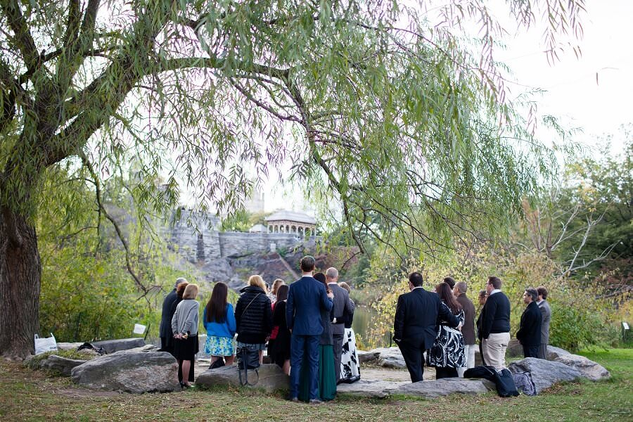 Intimate wedding under a willow tree along Turtle Pond