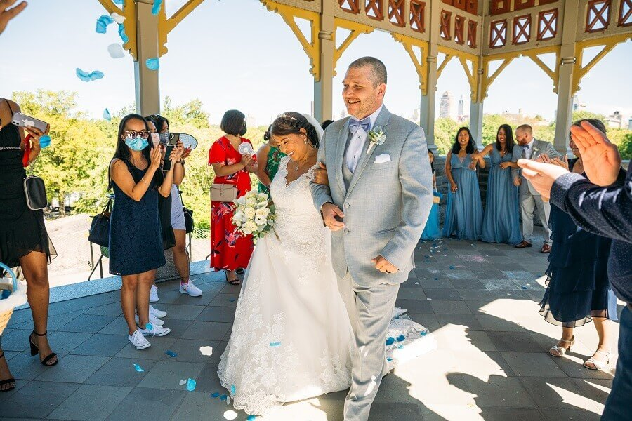 Couple recesses out after ceremony at Belvedere Castle Terrace in Central Park