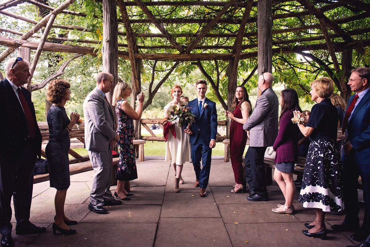 Newlyweds exit down aisle at Cop Cot after they are married