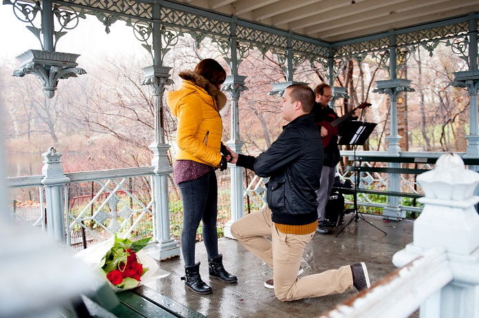 Man proposes to girlfriend in winter at the Ladies Pavilion with guitarist playing in background