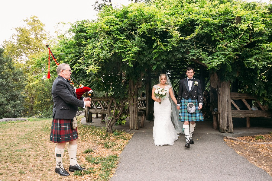 Scottish wedding couple exits Cop Cot with bagpipier