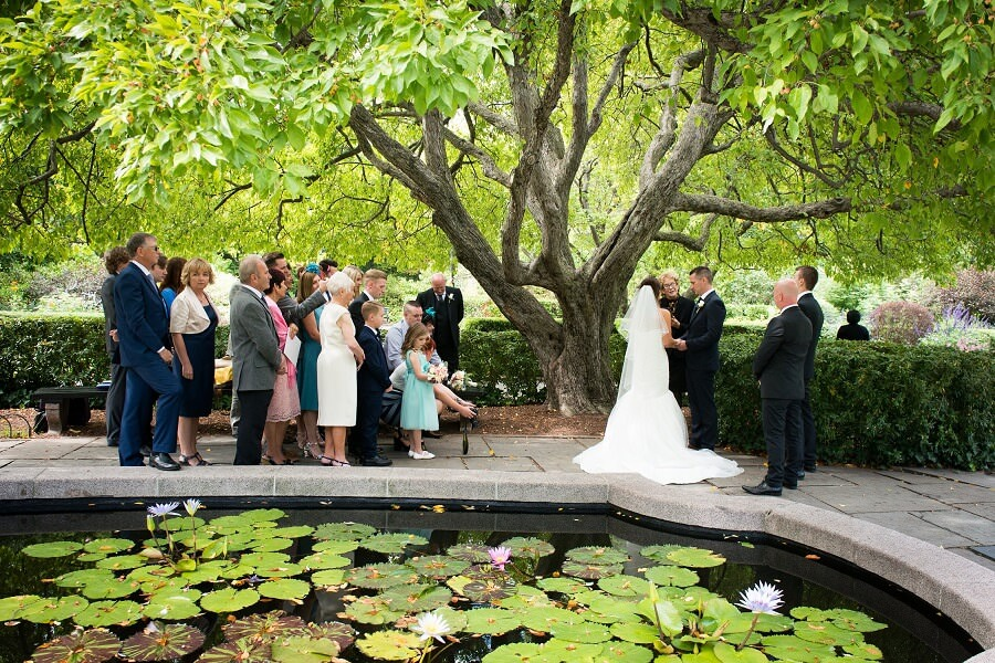 Couple exchanges wedding vows in Central Park's South Garden