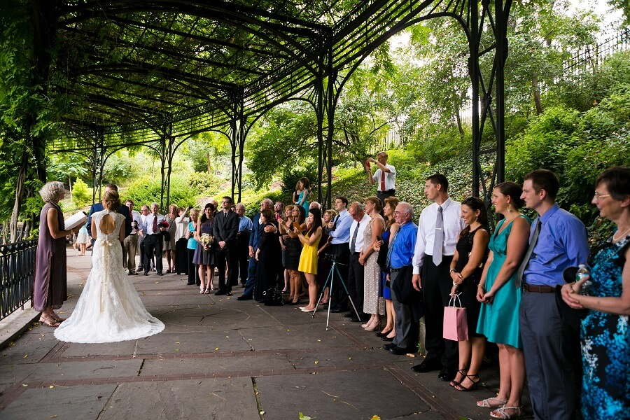 Large wedding ceremony at Wisteria Pergola in Conservatory Garden