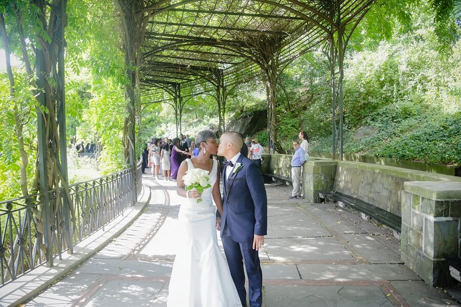 Bride and groom kiss after pronounced married at the Wisteria Pergola