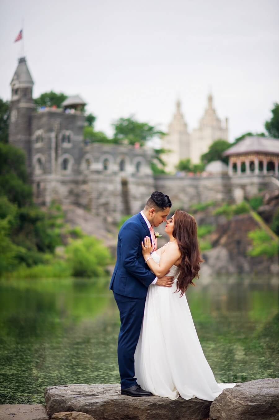Bride and groom pose with Belvedere Castle in the background