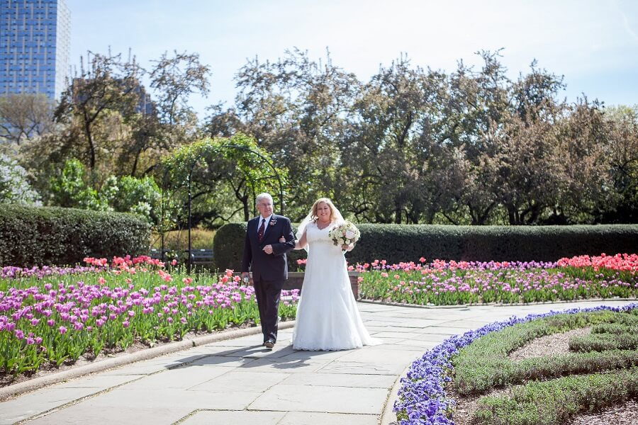 Father escorts bride down aisle in North Garden surrounded by tulips