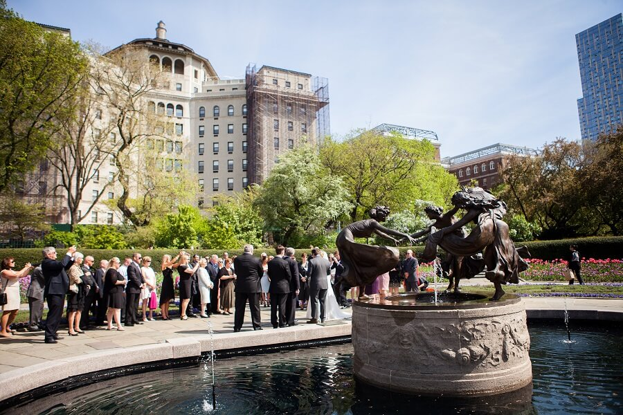 Large wedding ceremony next to fountain in North Garden