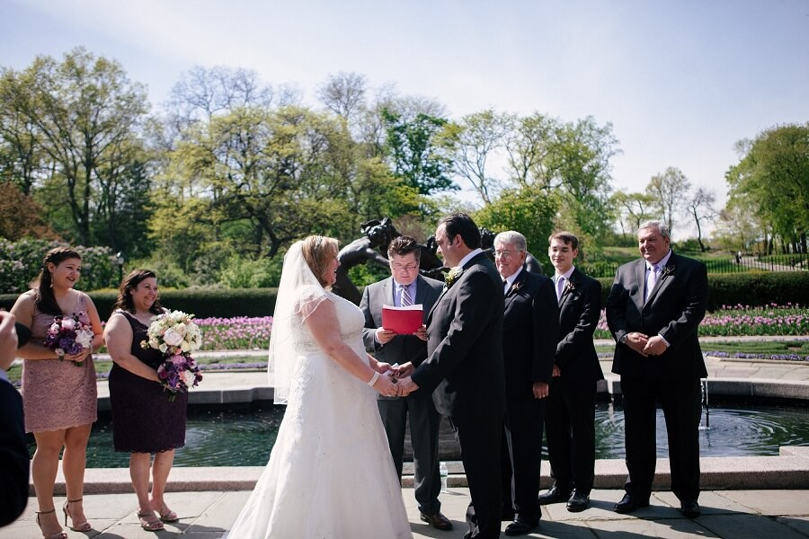 Bride and groom exchange vows in front of Untermyer fountain in Conservatory Garden