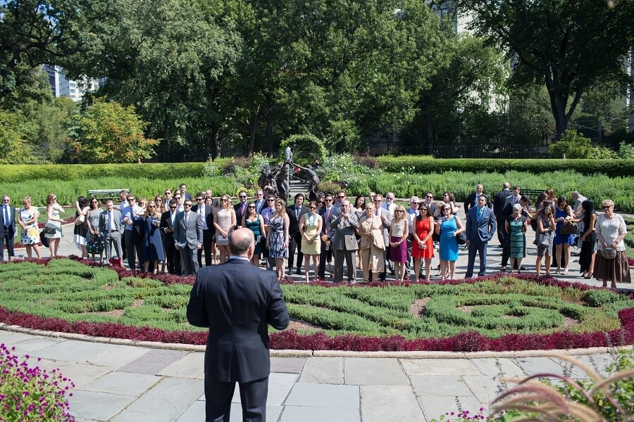 Officiant addresses guests before wedding ceremony in North Garden