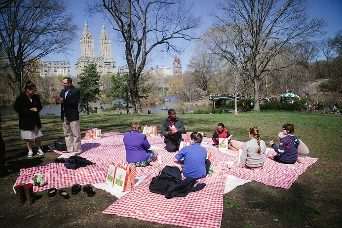 Group enjoys a picnic on Cherry Hill in Central Park