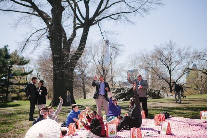 Picnickers wave goodbye in Central Park