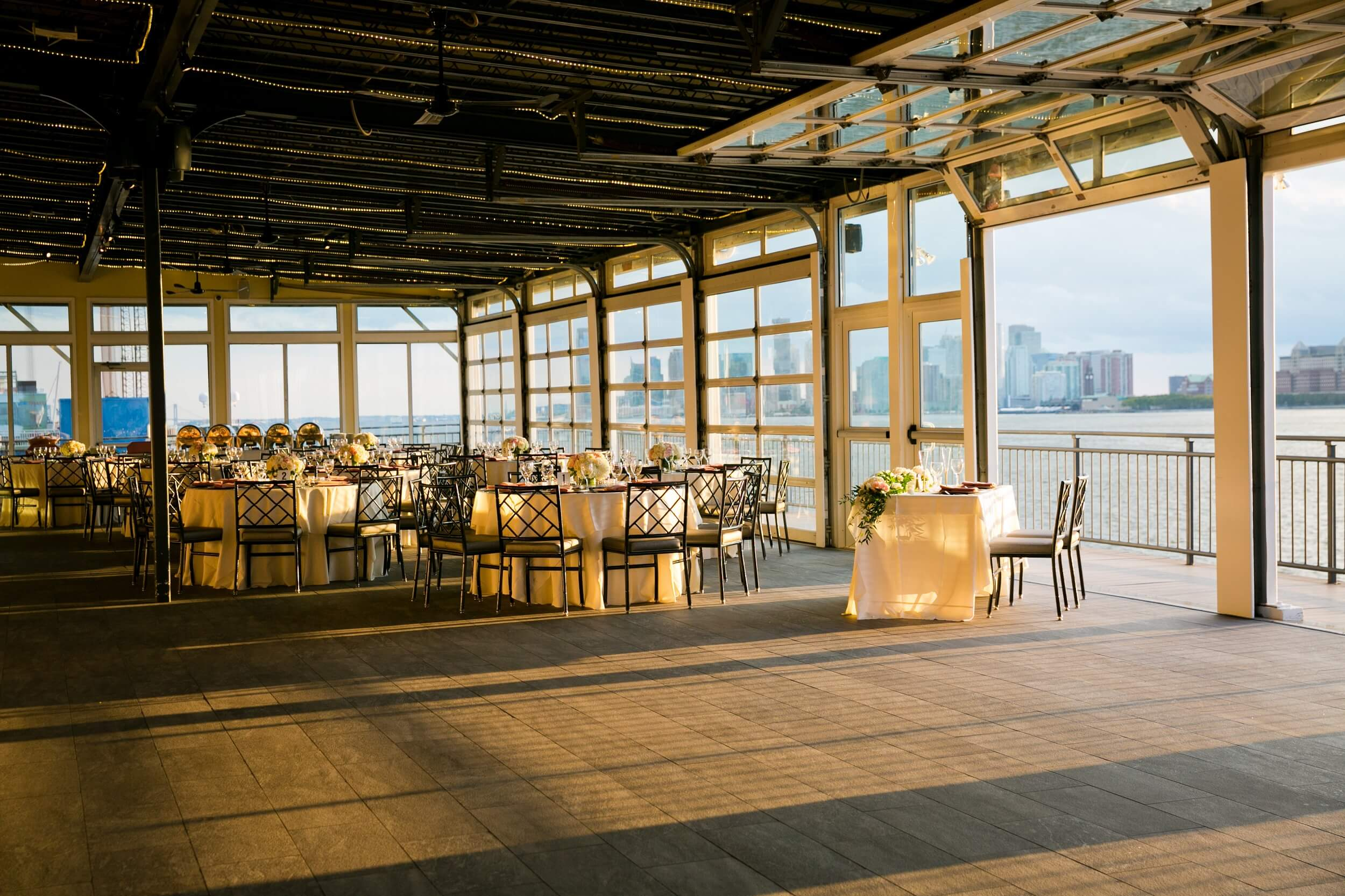 Tables at a wedding reception at Sunset Terrace during golden hour