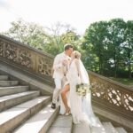 Bride and groom kiss on stairs at Bethesda Fountain