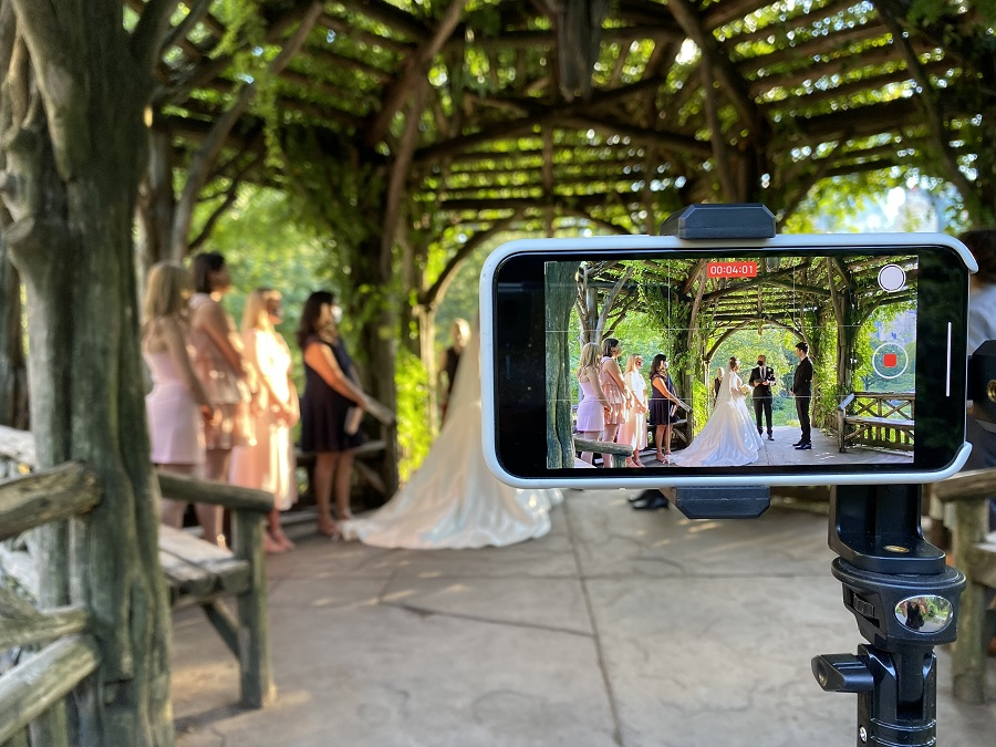 Closeup of phone showing videorecording of microwedding