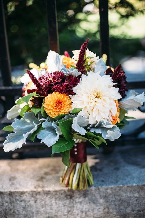 Fall bridal bouquet with burgundy dahlias